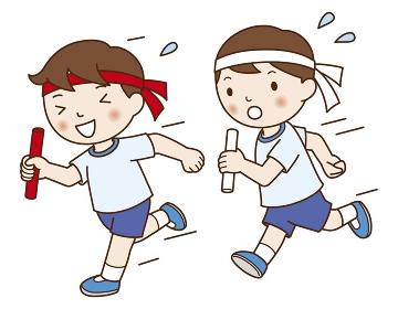 運動会で競走する男の子