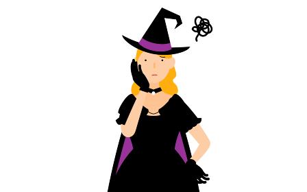 ハロウィンの仮装、魔女姿の女性が頬に手を当てて困っているポーズ