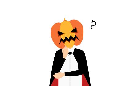 ハロウィンの仮装、カボチャのお化け姿の男の子が腕組みして悩むポーズ