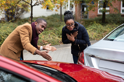 Man And Woman Arguing With Each Other After Car Accident