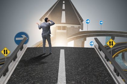 Young businessman in uncertainty concept with bridge