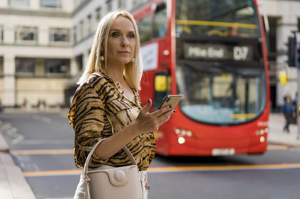 Businesswoman waiting for the right bus in London