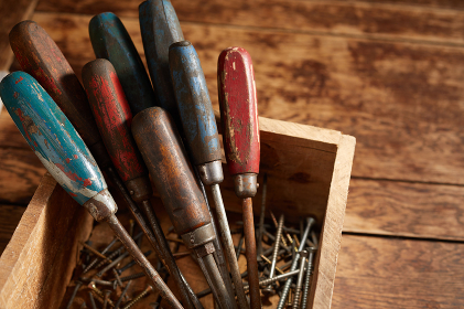 Old vintage screwdrivers with wooden handles