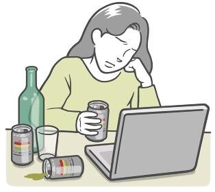 ノートPCを見ている、アルコール依存症の若い女性