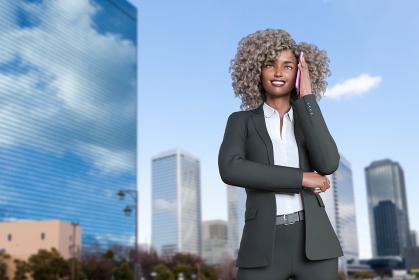 青空が綺麗な高層ビルが並ぶ大都市でパーマヘアの黒人女性がビジネススーツ姿で携帯電話で会話する