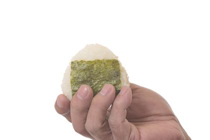 シニア男性の手とオニギリ