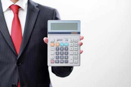 計算機を持つビジネスマン