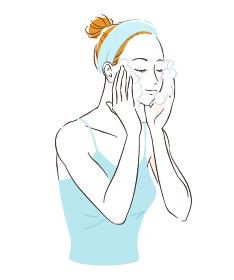 スキンケアをする女性 顔を洗う