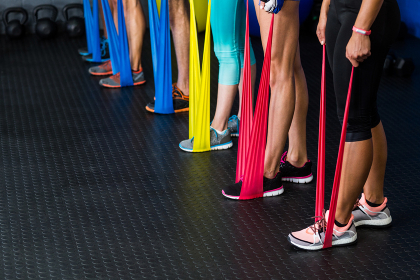 Athletes exercising with resistance band