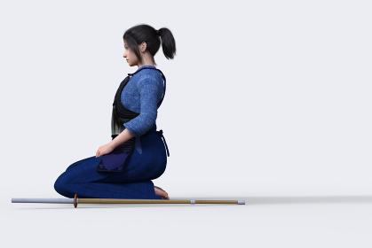 剣道の胴着をきて防具をつけた女の子が竹刀をよこに置き正座する