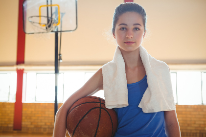 Portrait of female confident basketball player