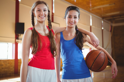 Portrait of smiling female basketball players