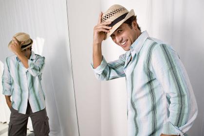 Man putting on hat