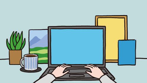 パソコン作業をしている手元とコーヒー 背景に観葉植物と額縁