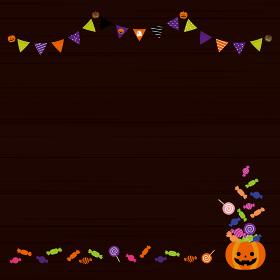 ハロウィンの背景素材。木目調の黒バック。お菓子いっぱいのパーティー(正方形)
