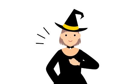 ハロウィンの仮装、魔女姿の女の子が胸を叩いているお任せあれのポーズ