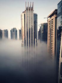 Golden glass modern skyscraper buildings of Dubai, global warming