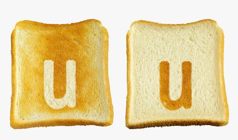 食パンに焼印風のアルファベットの小文字のu