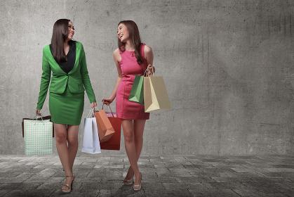 Beautiful two asian girls with shopping bags
