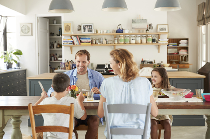 White family of four eating lunch in their kitchen at home