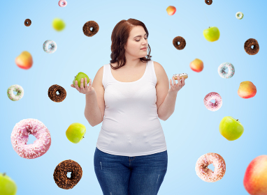 young plus size woman choosing apple or donut