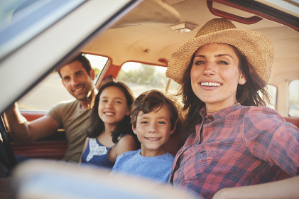 Portrait Of Family Relaxing In Car During Road Trip