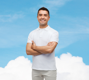smiling man in white t-shirt with crossed arms