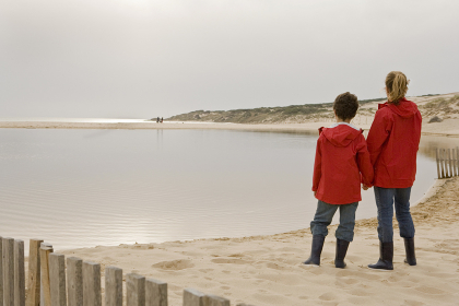 Mother and son looking out on beach