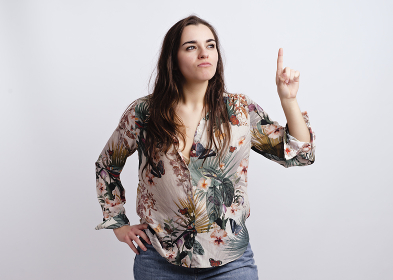 alternative young girl, in white background with printed shirt,
